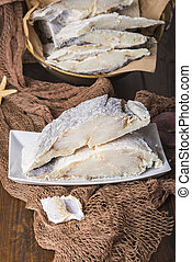 Uncooked salted cod on fishing nets - Uncooked salted...