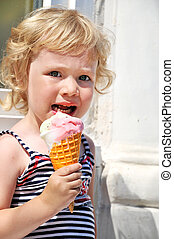 girl eating ice cream - little girl outdoors eating huge ice...