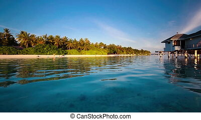water villas on tropical island - Panning view of the over...