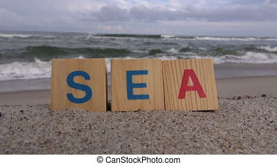 Word u201Cseau201D cubes on the beach - Word u201Cseau201D...