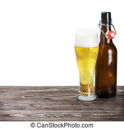 glass of beer and an empty bottle