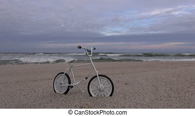 Toy bicycle in the resort beach sand by the sea
