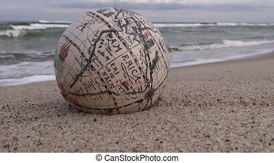 Retro globe on the sand by sea - Retro globe on the sand by...