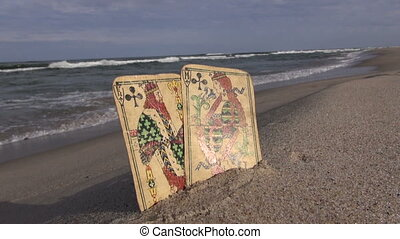 Two playing cards on the beach - Two antique used playing...