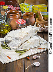Salted cod cut on the table of the kitchen - Salted cod cut...