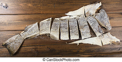 Traditional cut of salted cod on a wooden board