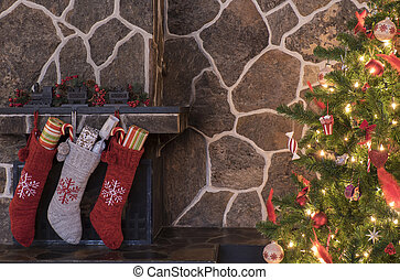 Christmas stockings and tree - Stockings hanging on a...