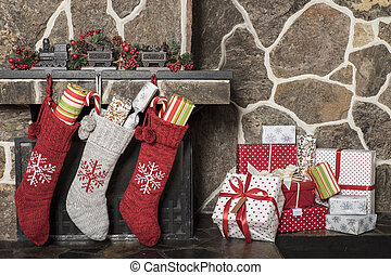 Christmas stockings and presents - Stuffed stockings hanging...