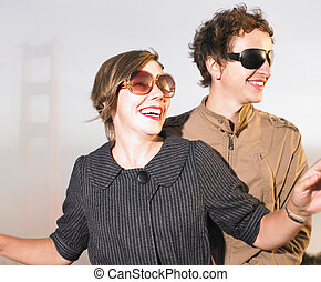Man and Woman Wearing Sunglasses - Mid adult woman and man...