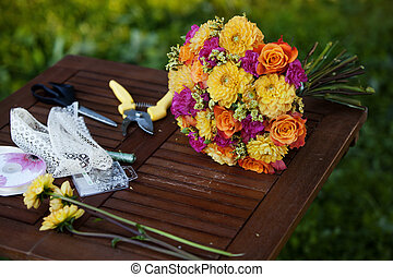 flowers and tools on the table, florist workplace, still life top view