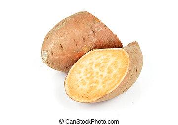Sweet Potato Cut in Half - Raw sweet potato cut in half on a...