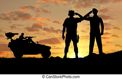 Silhouette of a soldier and the commander of a combat...