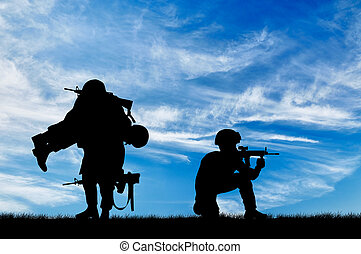 Silhouette of a soldier carries a wounded soldier - Concept...