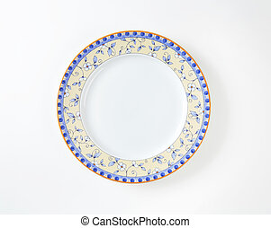 Dinner plate with subtle flower design on the rim
