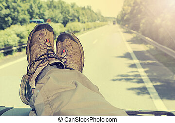 Hitch-hike travel - The cab of the truck. View of feet lying...