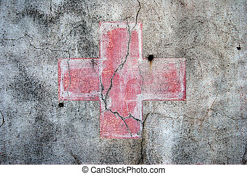 Red cross - A red cross on an abandoned grey wall