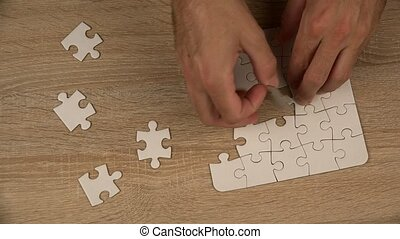 Man completing jigsaw puzzle, 4k uhd footage, 2160p,...