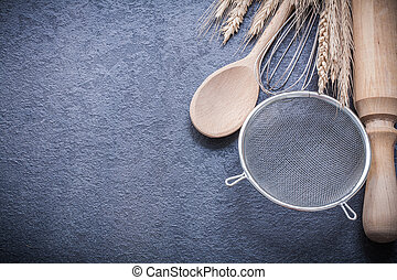 Ripe wheat rye ears spoon rolling-pin egg whisk sieve