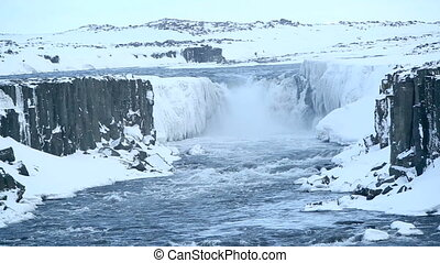 Waterfall Selfoss in wintertime - Waterfall Selfoss in...