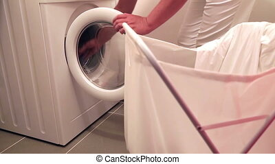 Woman using washing machine