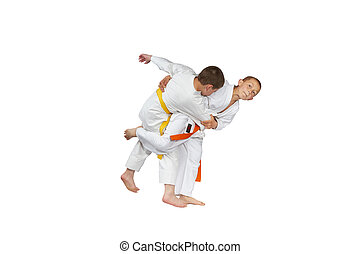 Athlete is doing judo throw - An athlete with an orange belt...
