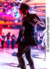 bokeh dancing - defocused background with bokeh lights in...