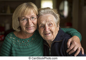 woman with his elderly mother.