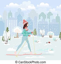 happy young woman cross country skiing in city park