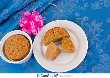 Moon cake - Chinese moon cake in white plate on blue table...