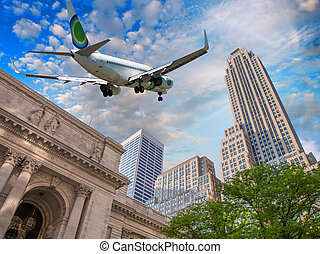 Airplane overflying Public Library and Fifth Avenue in New...
