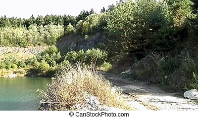 Lake formed by stone mining - Panorama view of jarero...