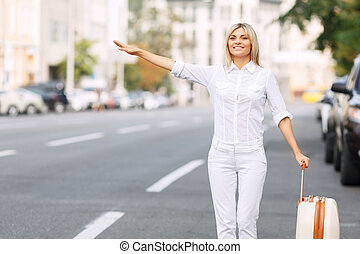 Nice woman standing near road - Waiting for car pull...