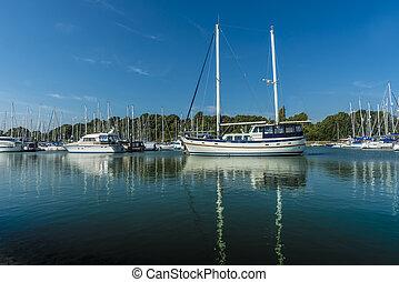Marina - Yachts moored in a sunny tranquil marina