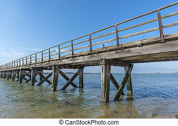Old wooden jetty - Old weathered wooden jetty on the...