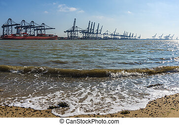 Container port - Ship being loaded at a container port that...