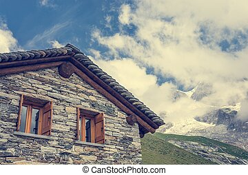 Mountain cabin Traditional stone building with a mountain...