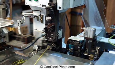 View of modern machine processes wire, close-up -...