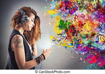 Tattoo girl listens to music with headphones