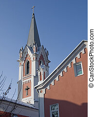Lutheran church with a bell tower against the blue sky.