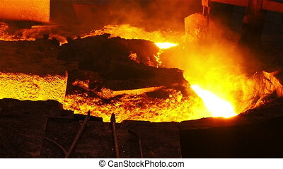 Molten metal and flames - Hot steel pouring in steel plant