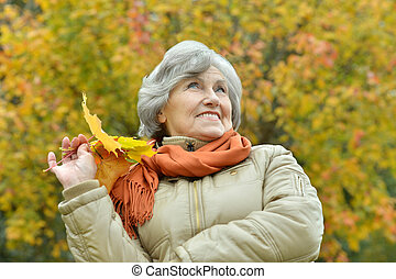 happy old woman - portrait of a happy old woman posing at...