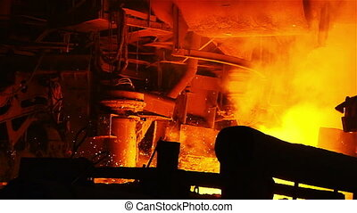 Firelight on the blast furnace - Hot steel pouring in steel...