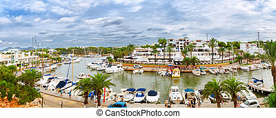 Panoramic view of the Cala D'Or yacht marina harbor with...