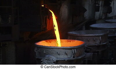 Slowly the current metal - Hot steel pouring in steel plant