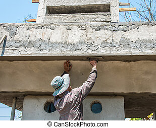 worker plasterize the ceiling and wall concrete