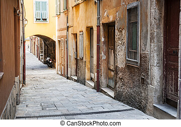 Old houses on narrow street in Villefranche-sur-Mer - Old...