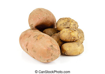 Potatoes and Sweet Potato - Small pile of brown unpeeled...