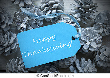 Light Blue Label On Fir Cones With Happy Thanksgiving