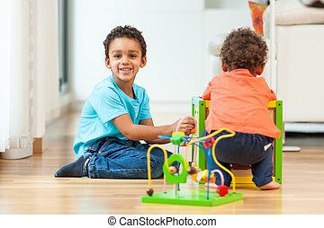 African american brothers child playing together
