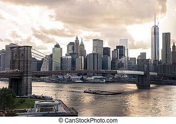 New York Skyline - Dowtown view of New York at sunset with...